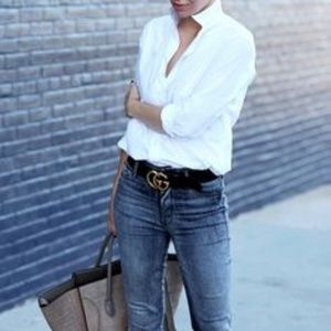 Classic white button up shirt with frayed hem.